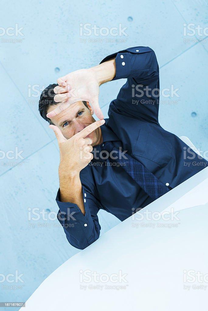 Businessman framing royalty-free stock photo