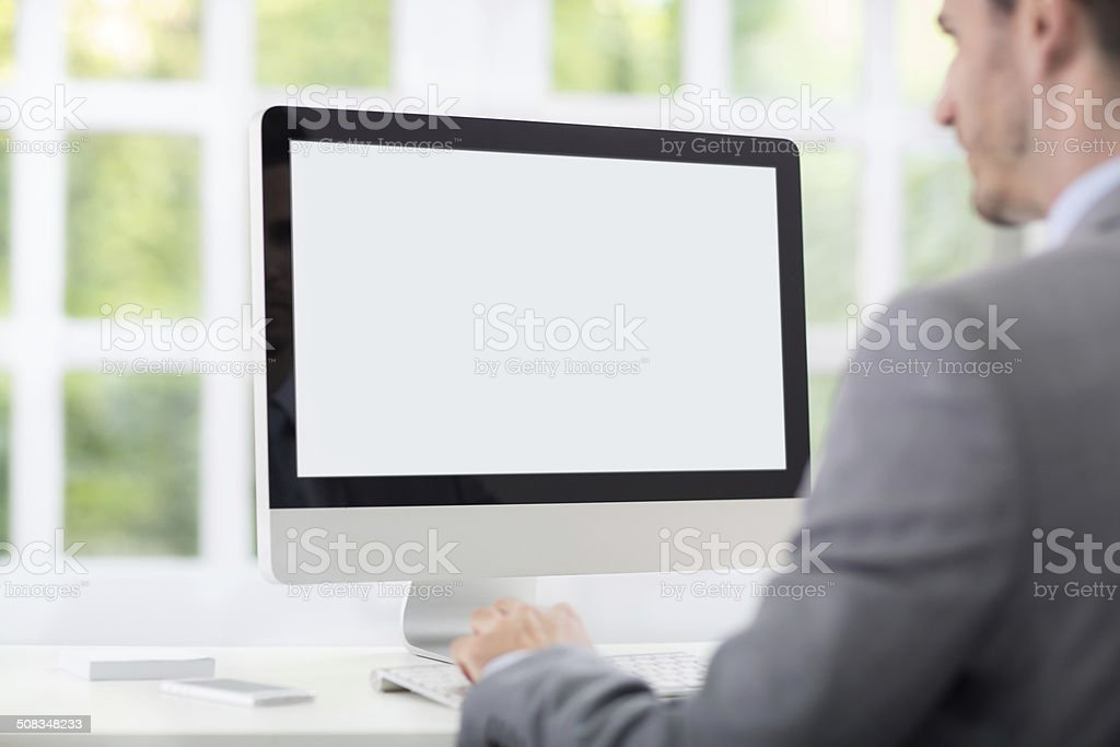 Businessman front of desktop stock photo