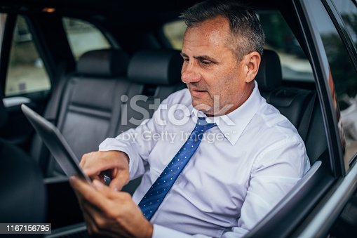 960164282istockphoto Businessman getting data on tablet device 1167156795