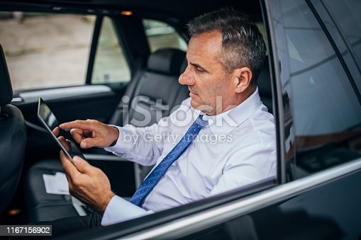 960164282istockphoto Businessman getting data on tablet device 1167156902