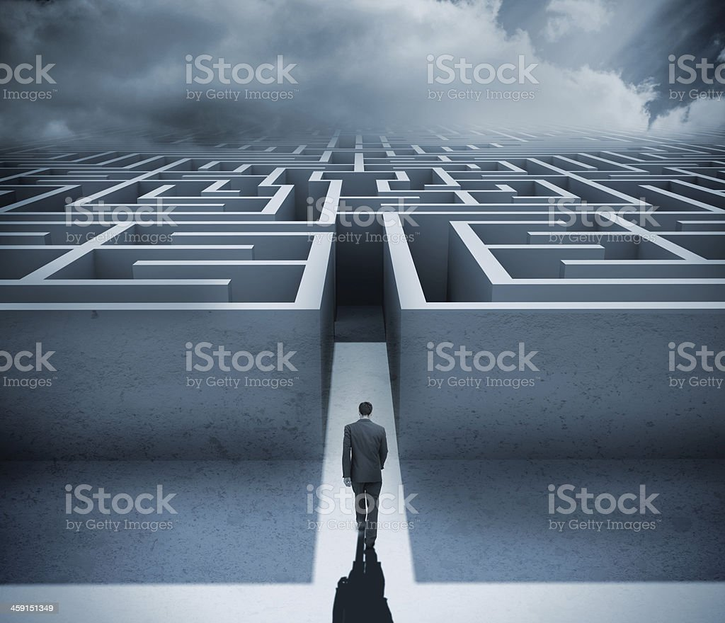 Businessman getting in a maze stock photo
