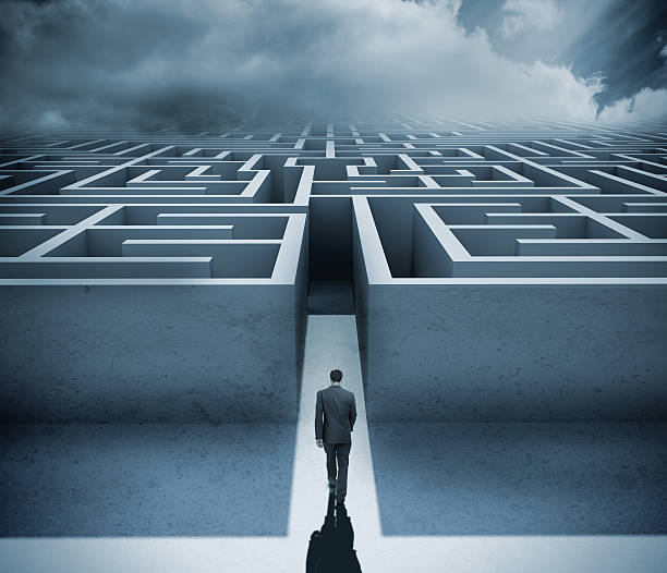 businessman getting in a maze - maze stock photos and pictures
