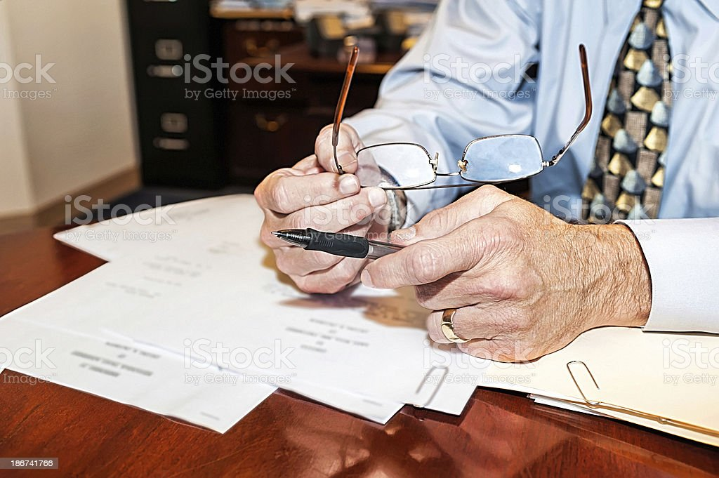 Businessman getting ready to sign documents royalty-free stock photo