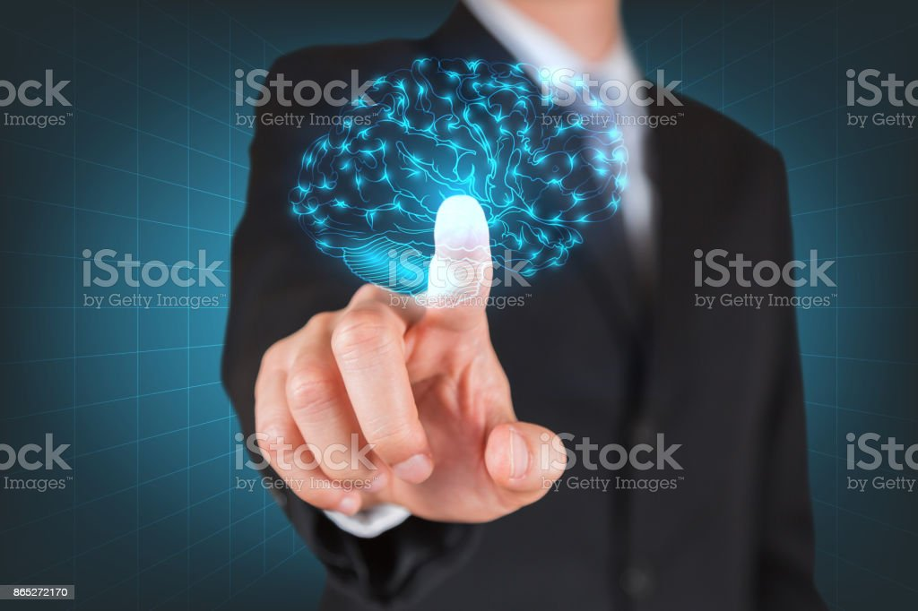 Businessman give a thumbs up for touching the glowing hologram brain as business, innovation, intelligent, idea and brainstorming concept. stock photo