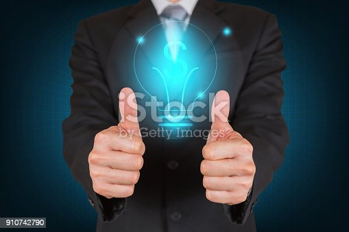 693589426istockphoto Businessman give a two thumbs up for compliment with dollar sign Light bulb on dark blue background as business, investment, praise, congratulate, good and like concept. 910742790