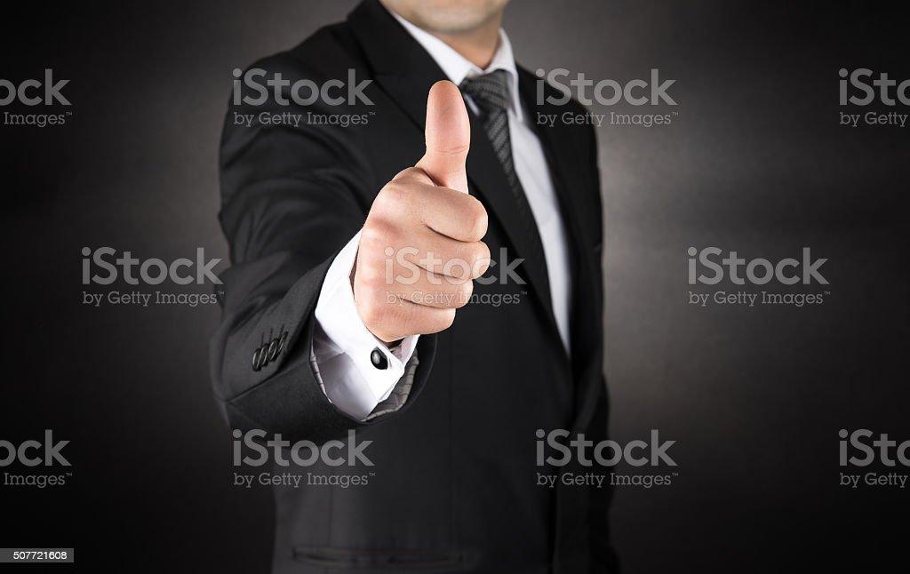 Businessman Gives a Thumb Up royalty-free stock photo