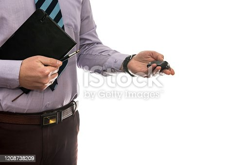 istock businessman gives car keys to car isolated on white background. 1208738209