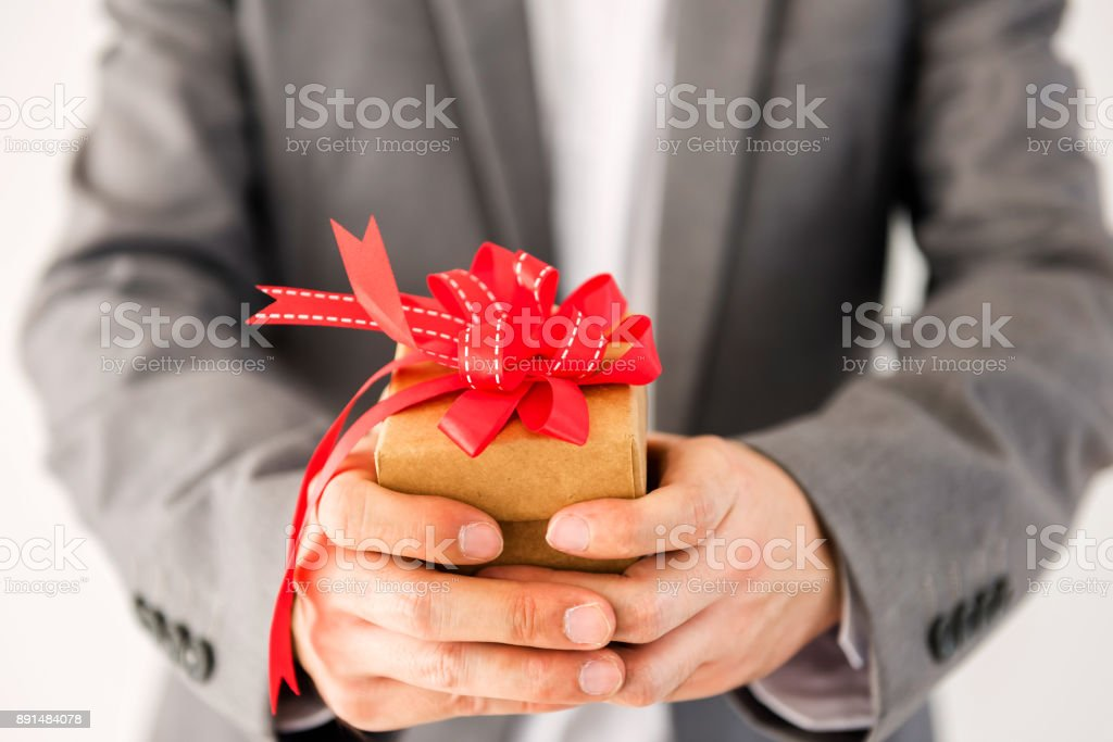 Businessman Giving A Gift With Red Ribbon