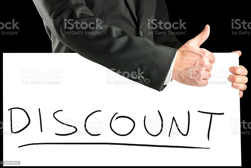 Businessman giving a thumbs up for  discount stock photo
