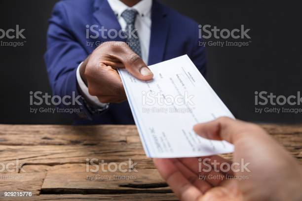 Businessman giving cheque to his colleague picture id929215776?b=1&k=6&m=929215776&s=612x612&h=pxdainnjzahun81205rsllo8xu63zjwy5u5uikcevfw=