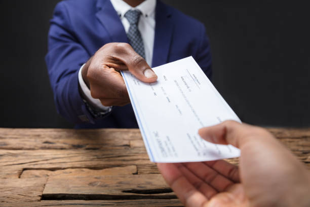 Businessman giving cheque to his colleague picture id929215776?b=1&k=6&m=929215776&s=612x612&w=0&h=ms0tfea3ksjxwc0g0 morrartuc7w50d2jn4ubj1og8=