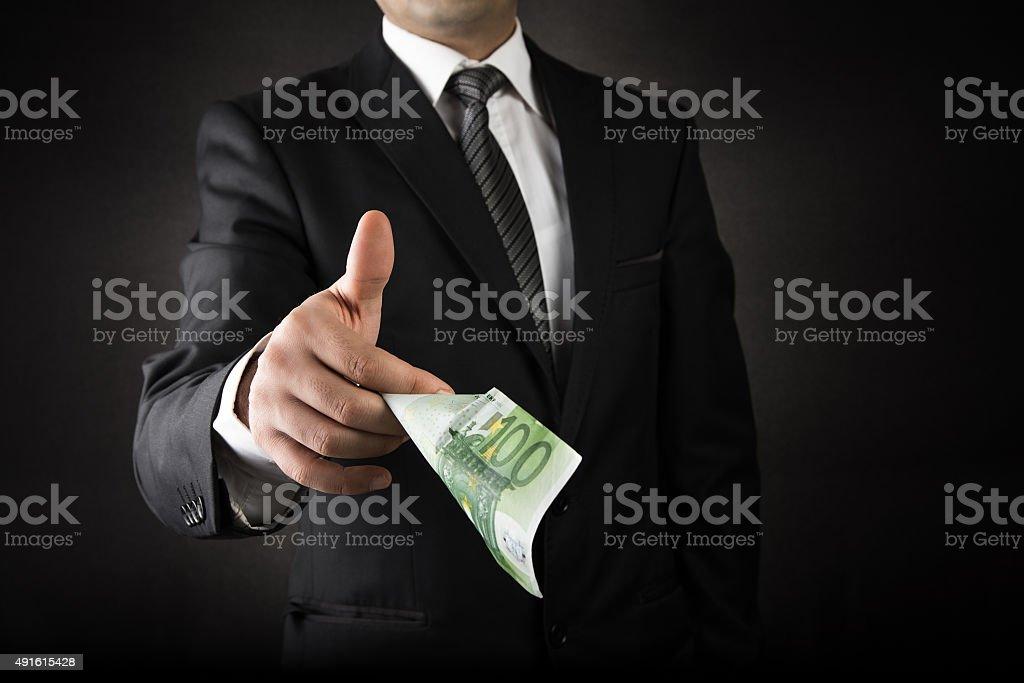 Businessman Giving Euro stock photo