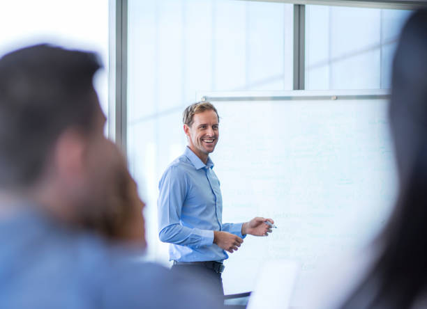 businessman giving presentation to colleagues - selective focus stock pictures, royalty-free photos & images