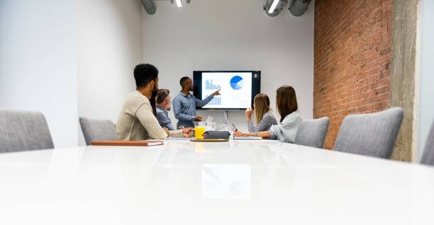 Businessman giving presentation with colleagues