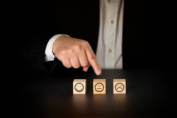 Businessman giving rating with average icon. Satisfaction survey concept stock photo