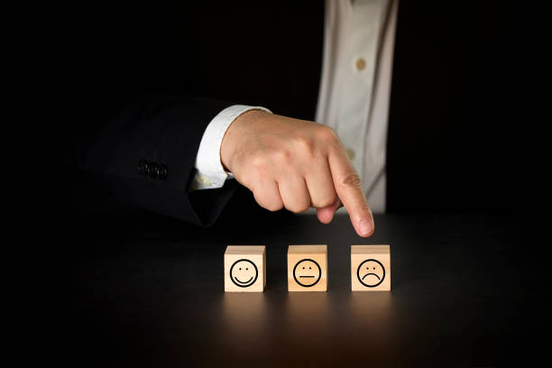 Businessman giving rating with bad icon. Satisfaction survey concept stock photo