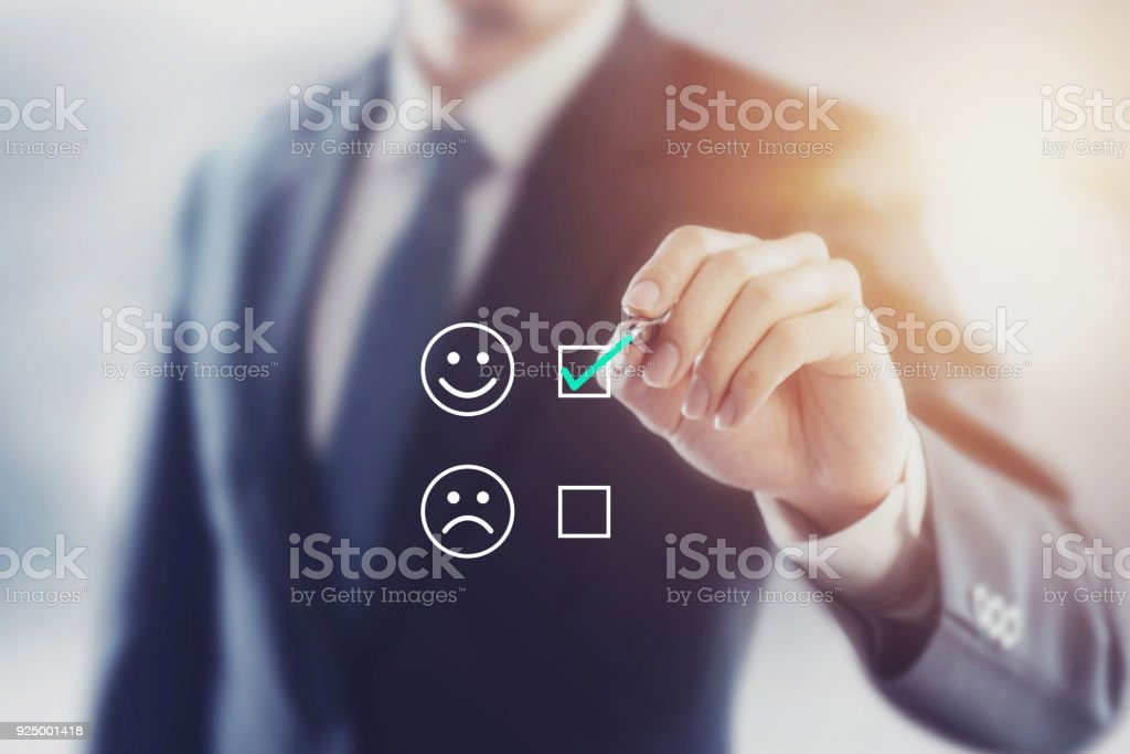 Businessman giving rating with happy icon, Customer satisfaction survey concept stock photo