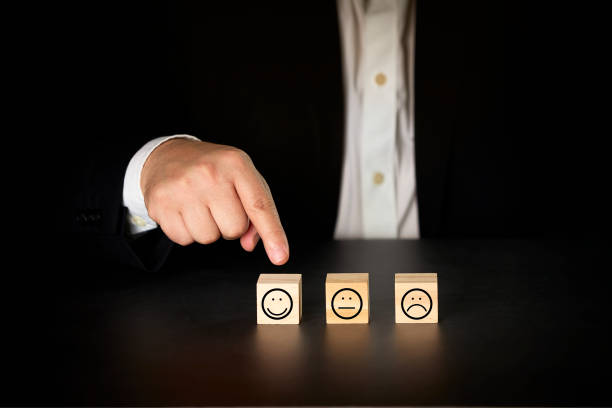 Businessman giving rating with happy icon. Satisfaction survey concept stock photo