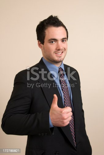 Businessman giving the thumbs up