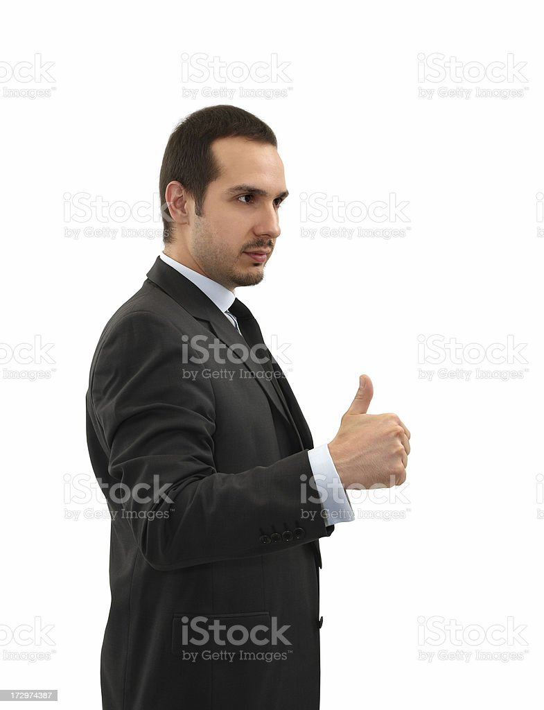 Businessman Giving Thumbs Up Young businessman giving thumbs up. Isolated on white background. Achievement Stock Photo