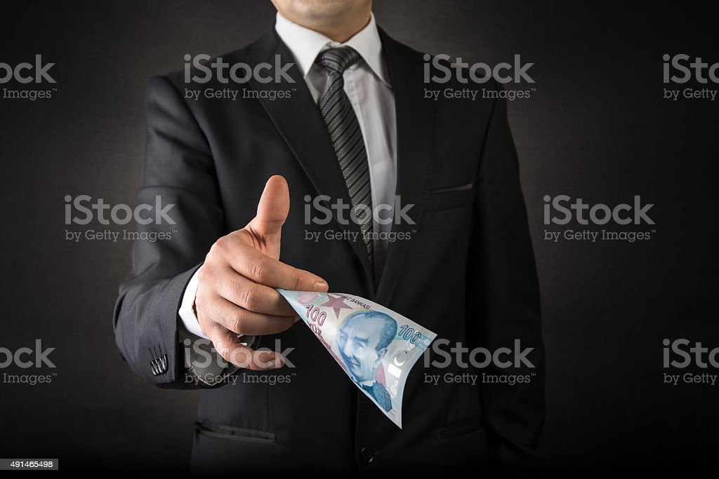 Businessman Giving Turkish Lira stock photo