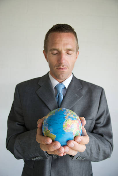 Businessman Globe Crystal Ball stock photo