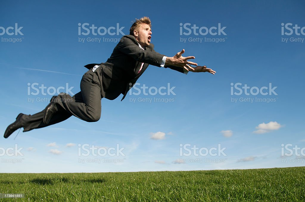 Businessman Goes for a Flying Save Green Meadow stock photo