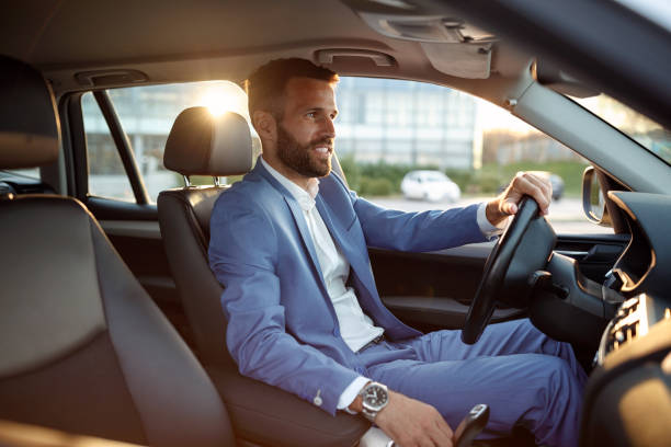 businessman going on business trip by car stock photo
