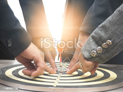 istock Businessman group point to a darts aiming at the target center, Target marketing, and business success concept 1186692736