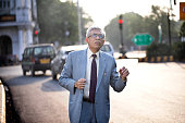 istock Businessman hailing taxi in city 1252292716