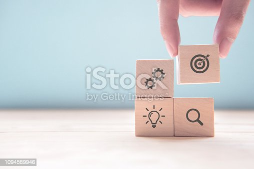 istock Businessman hand arranging wood block with icon business strategy and Action plan, copy space. 1094589946