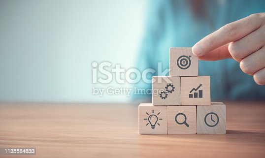 istock Businessman hand arranging wood block with icon business strategy and Action plan, copy space. 1135584833