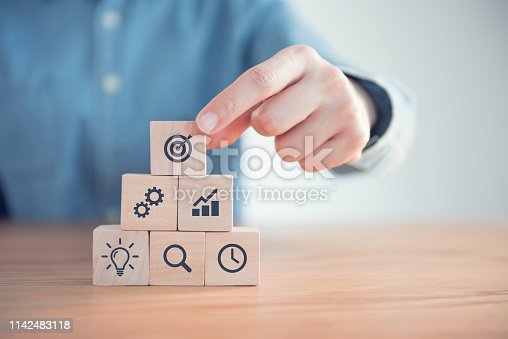 istock Businessman hand arranging wood block with icon business strategy and Action plan, copy space. 1142483118