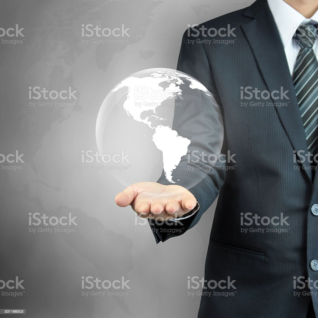 Businessman hand carrying the globe with world map stock photo