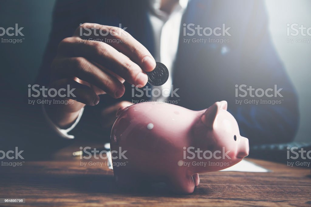 businessman hand coin and piggy bank royalty-free stock photo