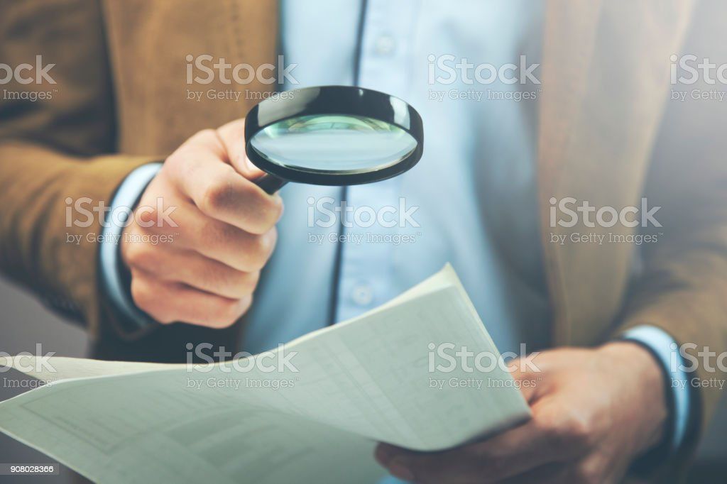 Businessman hand document and magnifier stock photo