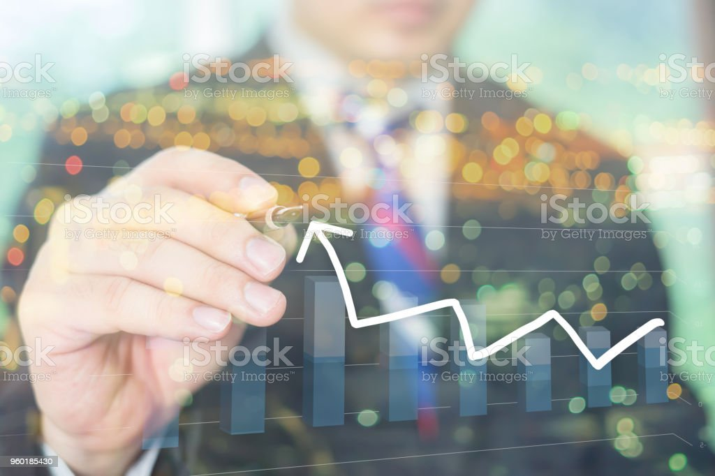 Businessman Hand drawing a stairs in a Conceptual Image with a strategy  marketing plan to be successful in his business growth and graph progress ,vintage ,double exposure concept stock photo