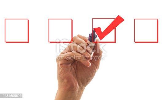 Businessman hand drawing check mark symbol