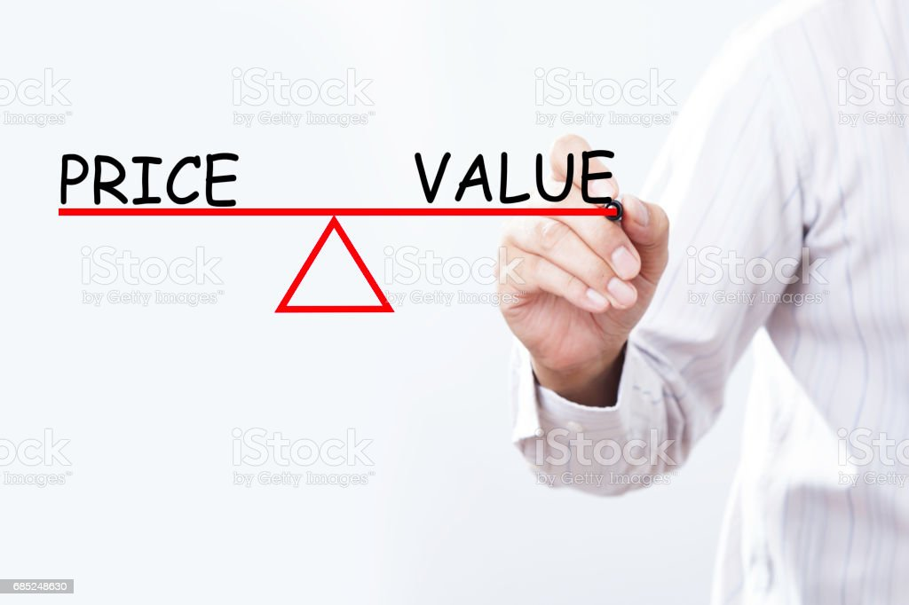 Businessman hand drawing Price and Value balance - Business concept. royalty-free stock photo