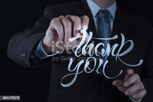 513601840 istock photo businessman hand drwing design word THANK YOU 484475375