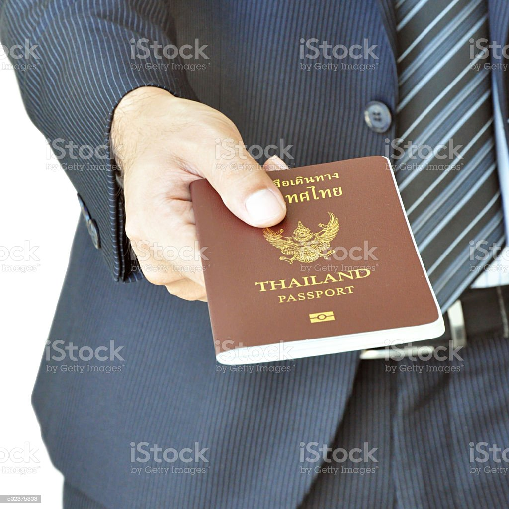 Businessman hand giving passport royalty-free stock photo
