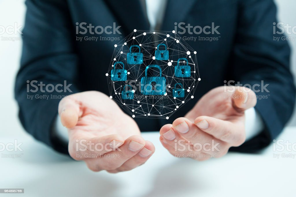businessman hand globe lock in screen royalty-free stock photo