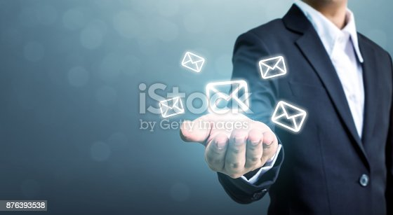 istock Businessman hand holding e-mail icon, Contact us by newsletter email and protect your personal information from spam mail concept 876393538
