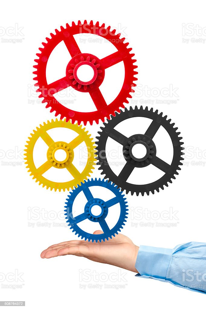 Businessman hand holding gears isolated stock photo