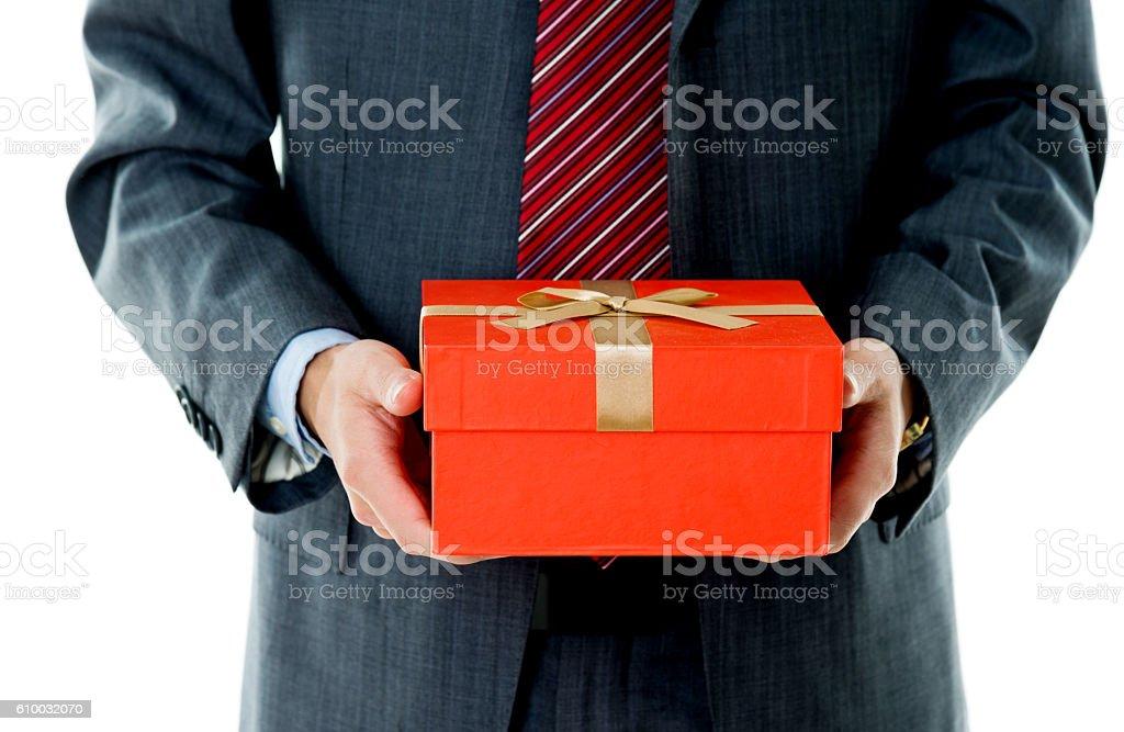 Businessman Hand Holding Gift Box