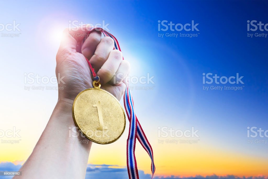Businessman hand holding golden coin medal. stock photo