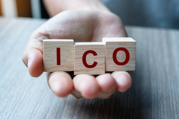 Businessman hand holding ICO (Initial Coin Offering) word with wooden cube block, is the cryptocurrency industry equivalent to an Initial Public Offering (IPO). Stock, Fund, Investors and Investment Businessman hand holding ICO (Initial Coin Offering) word with wooden cube block, is the cryptocurrency industry equivalent to an Initial Public Offering (IPO). Stock, Fund, Investors and Investment initial coin offering stock pictures, royalty-free photos & images