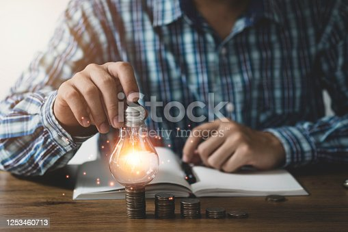 637573406 istock photo Businessman hand holding lightbulb with cog gear and connection line. Creative thinking idea concept. 1253460713
