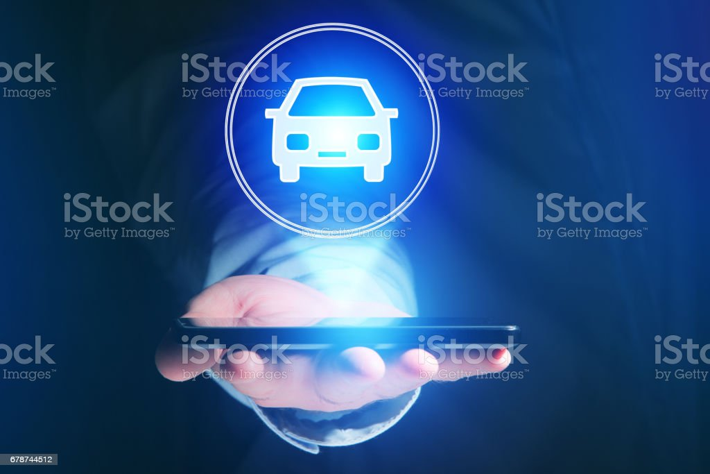 Businessman hand holding mobile phone with car icon stock photo