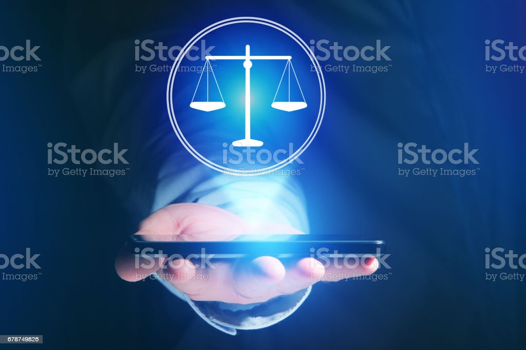 Businessman hand holding mobile phone with justice icon stock photo